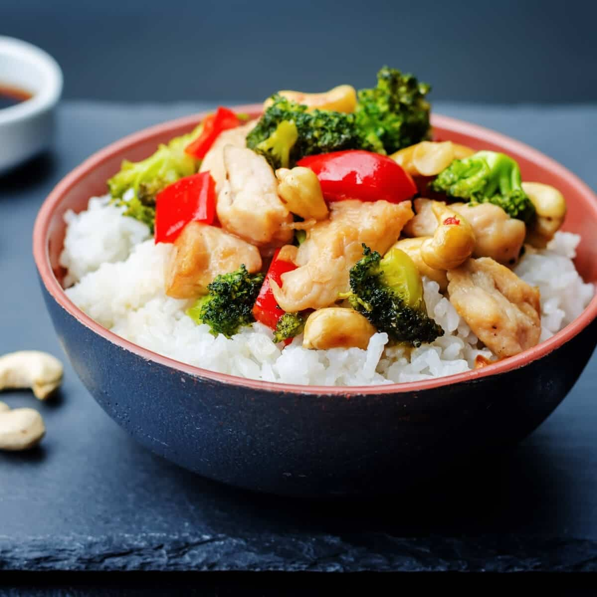 stir fry over rice in bowl