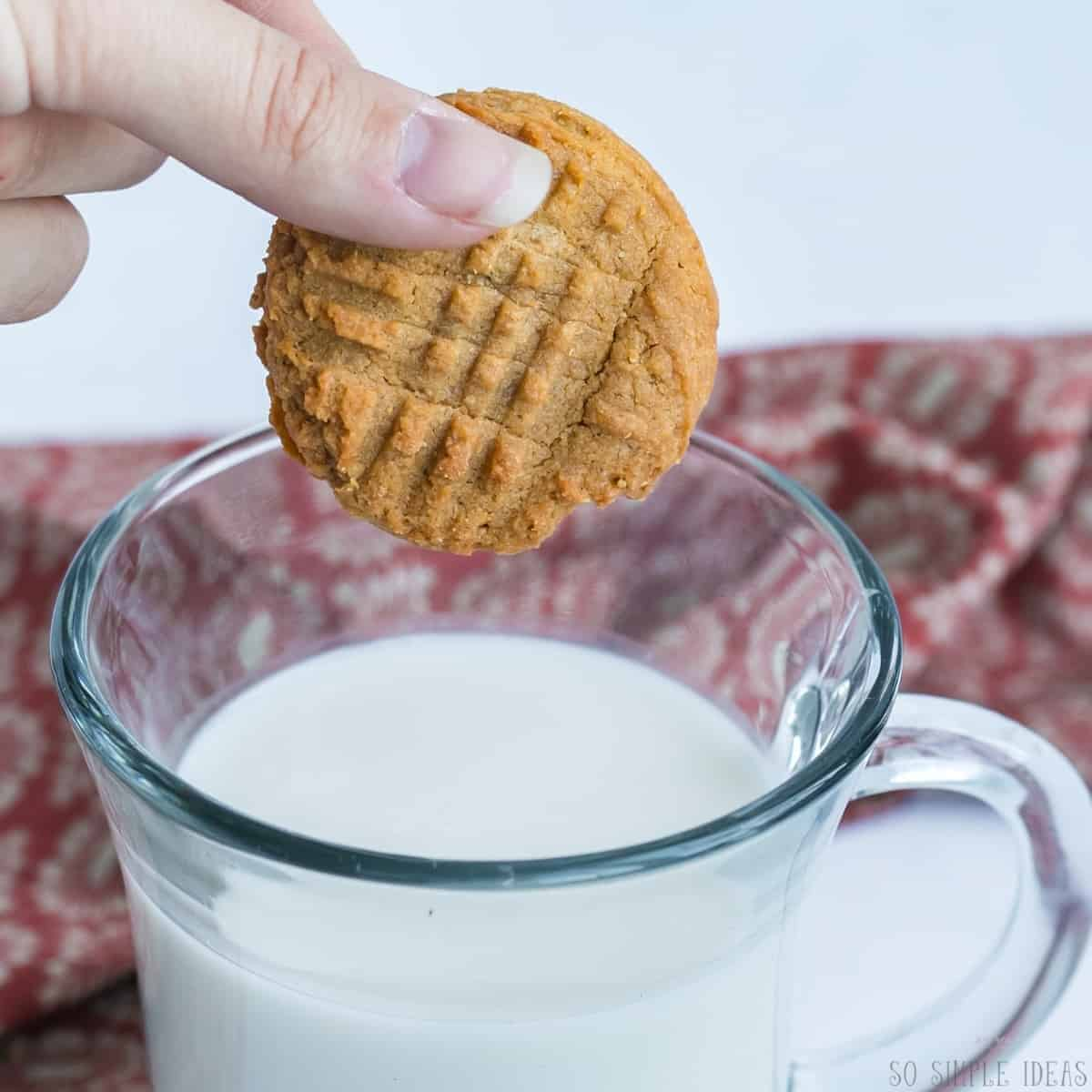 dipping cookie in milk